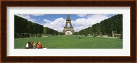 Tourists sitting in a park with a tower in the background, Eiffel Tower, Paris, Ile-de-France, France Fine Art Print