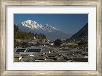 High angle view of houses with Jade Dragon Snow Mountain in the background, Old Town, Lijiang, Yunnan Province, China Fine Art Print