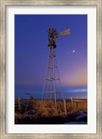 Venus and Jupiter are visible behind an old farm water pump windmill, Alberta, Canada Fine Art Print