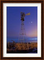 Venus and Jupiter are visible behind an old farm water pump windmill, Alberta, Canada Fine Art Print