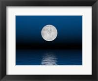 Beautiful full moon against a deep blue sky over the ocean Fine Art Print