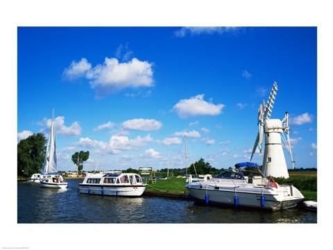 Framed Boats moored near a traditional windmill, River Thurne, Norfolk Broads, Norfolk, England Print