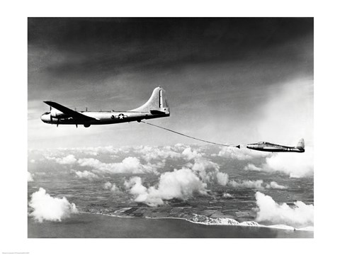 Side profile of a military tanker airplane refueling in flight, B-29 ...