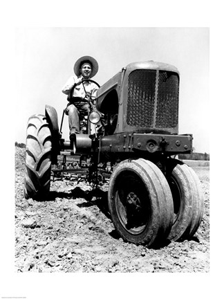 Framed Farmer Sitting on a Tractor in a Field Print