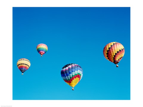 Framed 4 Rainbow Hot Air Balloons in the Bright Blue Sky Print