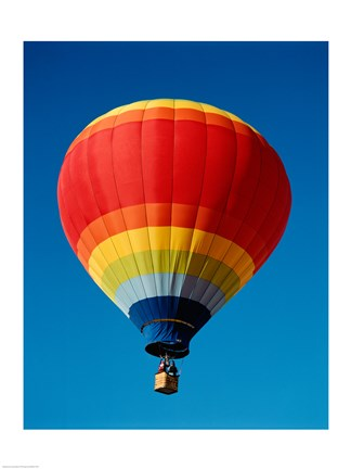 Framed Low angle view of a hot air balloon in the sky, New Mexico, Rainbow Print