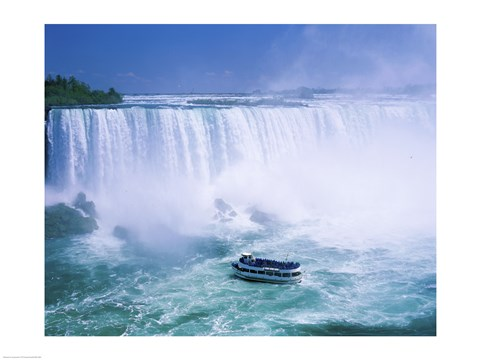 Framed High angle view of a tourboat in front of a waterfall, Niagara Falls, Ontario, Canada Print