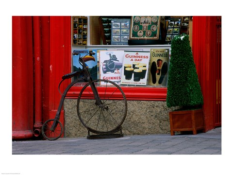 Framed Old bicycle in front of a store, Kilkenny, Ireland Print
