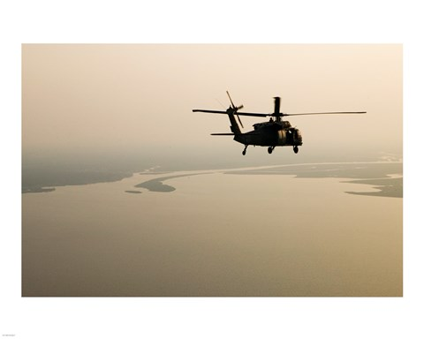 Framed Air Force helicopter flys over Lake Pontchatrain to New Orleans Print