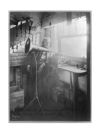 Framed Thomas Alva Edison, full-length portrait, standing, facing right, listening to a new record Print