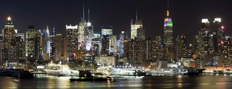 Framed Buildings in a city lit up at night, Hudson River, Midtown Manhattan, Manhattan, New York City, New York State, USA Print