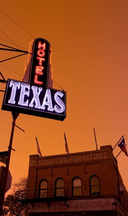 Framed Low angle view of a neon sign of a hotel lit up at dusk, Fort Worth Stockyards, Fort Worth, Texas, USA Print