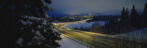 Winding road running through a snow covered landscape, Anchorage, Alaska, USA by Panoramic Images