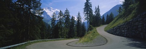 Framed Empty road passing through mountains, Bernese Oberland, Switzerland Print