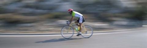 Framed Bike racer participating in a bicycle race, Sitges, Barcelona, Catalonia, Spain Print