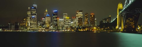 Framed Buildings at the waterfront lit up at night, Sydney Harbor Bridge, Sydney, New South Wales, Australia Print