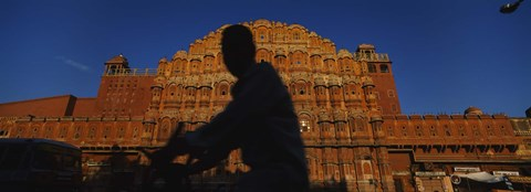 Framed Silhouette of a person riding a motorcycle in front of a palace, Hawa Mahal, Jaipur, Rajasthan, India Print