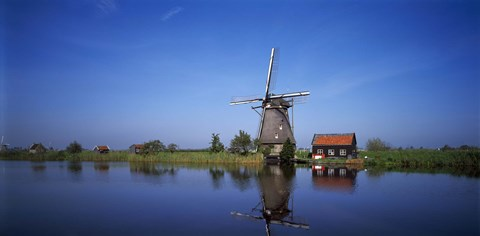 Framed Reflection of a traditional windmill in a lake, Netherlands Print