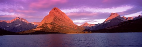 Lake with mountains at dusk, Swiftcurrent Lake, Many Glacier, US Glacier National Park, Montana, USA by Panoramic Images