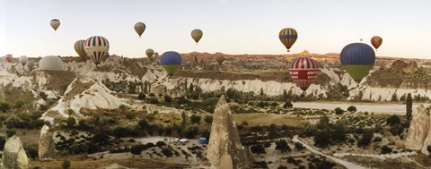 Framed Mulit colored hot air balloons at sunrise over Cappadocia, Central Anatolia Region, Turkey Print