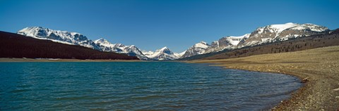 Lake with snow covered mountains in the background, Sherburne Lake, US Glacier National Park, Montana, USA by Panoramic Images