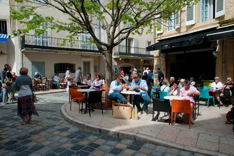 Framed Tourists at sidewalk cafes, Lourmarin, Vaucluse, Provence-Alpes-Cote d'Azur, France Print