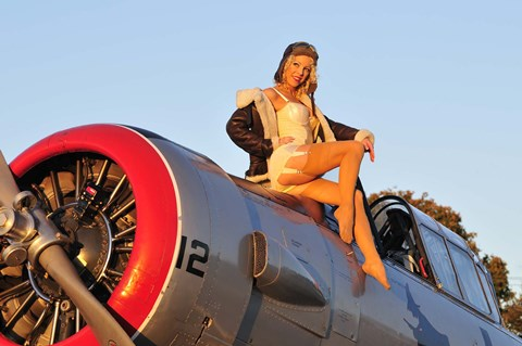 Framed 1940's style aviator pin-up girl posing with a vintage T-6 Texan aircraft Print
