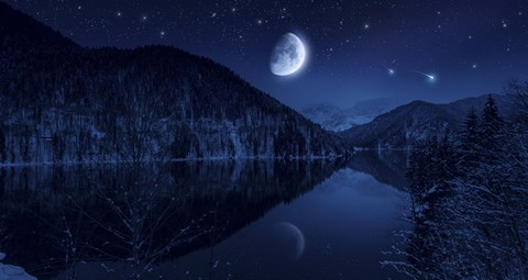 Framed Moon rising over tranquil lake in the misty mountains against starry sky Print