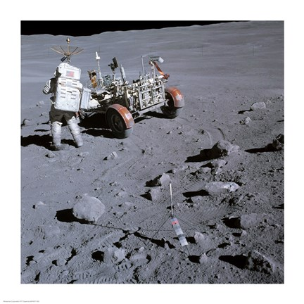 Framed Astronaut walking near the lunar rover on the moon, Apollo 16 Print