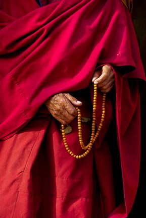 Framed Hands of a monk in red holding prayer beads, Leh, Ladakh, India Print