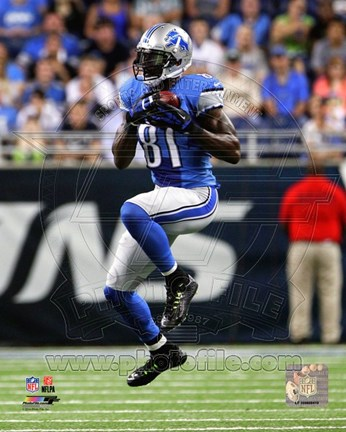 Framed Calvin Johnson 2014 Playing Football Print