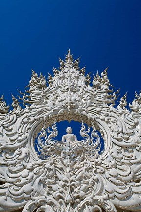 Framed new all white temple of Wat Rong Khun in Tambon Pa O Don Chai designed by Chalermchai Kositpipat. Print