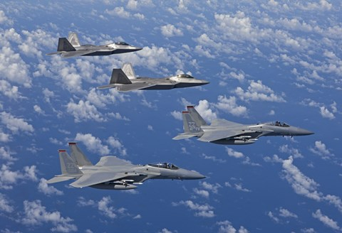 Framed F-15 Eagles and F-22 Raptors Fly in Formation Print