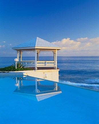 Framed Gazebo reflecting on pool with sea in background, Long Island, Bahamas Print