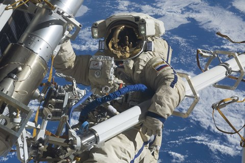 Framed Russian Cosmonaut Participates in a Session of Extravehicular Activity Print