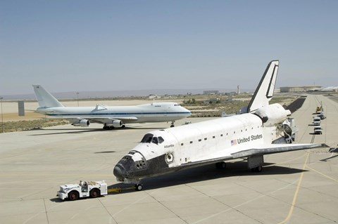 Framed Space shuttle Atlantis is Towed Past a Modified Boeing 747 Print
