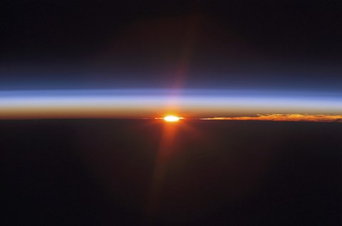 Framed Layers of Earth's atmosphere, brightly colored as the sun sets over South America Print