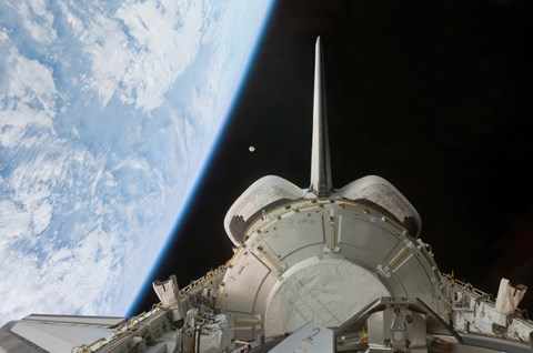 Framed Space Shuttle Discovery's Payload Bay Backdropped by Earth's Horizon Print