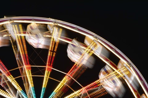 Framed Blurred Motion Carnival Ride at Night Print