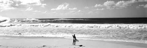Framed Surfer standing on the beach, North Shore, Oahu, Hawaii Print