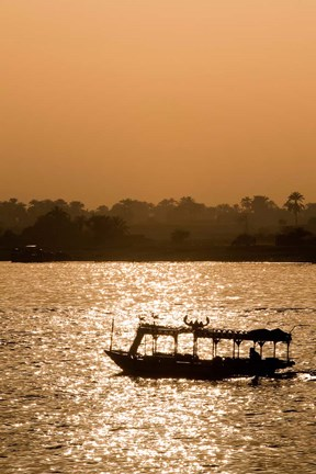 Framed Egypt, Luxor Water taxi at sunset Nile River Print