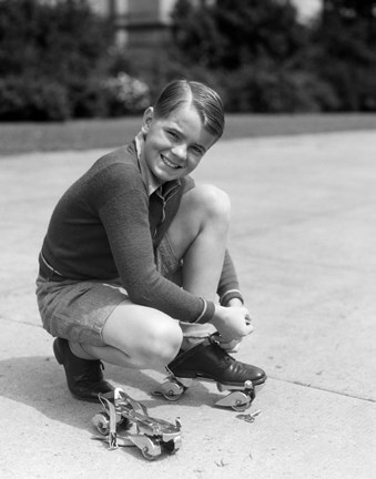 Framed 1930s Smiling Boy Fastening On Metal Roller Skates Print