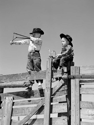 Framed 1950s Two Young Boys Dressed As Cowboys Print