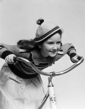 Framed 1930s Smiling Eager Little Girl In Knit Cap And Sweater Riding Bike Print
