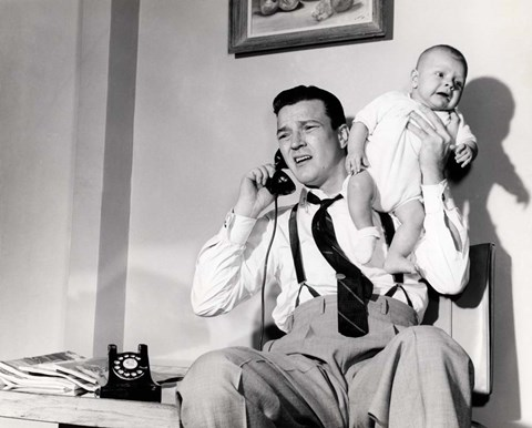 Framed 1950s Father Holding Baby While On The Phone Print